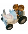 Beeldje bruid en bruidegom in tractor